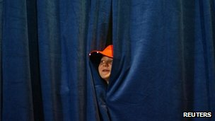 Republican vice presidential candidate Paul Ryan's son Sam peeps through the curtains at a campaign event in Des Moines, Iowa 5 November 2012