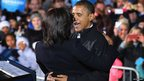 Barack Obama embraces first lady Michelle Obama during his last rally the night before the general election in Des Moines, Iowa.