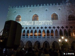 """Signal received"" message projected on wall in Venice"