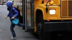 Pupil getting off New York schoolbus