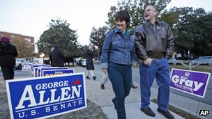 Democratic Senate candidate, former Gov. Timothy Kaine, and his wife, Anne Holton, walk back home after voting in Richmond, Virginia 6 November 2012