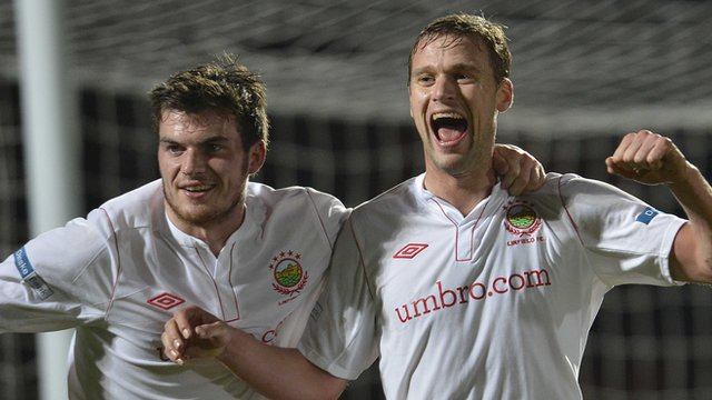 Philip Lowry celebrates with goal scorer Peter Thompson