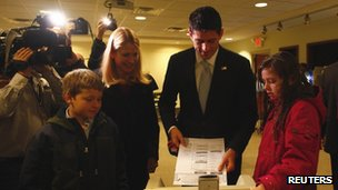 Republican vice presidential candidate Paul Ryan casts his ballot with his wife Janna, son Charlie and daughter Liza on election day in Janesville, Wisconsin 6 November 2012