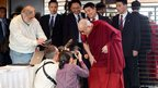 Dalai Lama poses for photographers