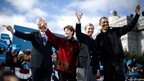 US President Barack Obama (right) gathers on stage with (left to right) former President Bill Clinton, Senator Jeanne Shaheen and New Hampshire Governor John Lynch at an election campaign rally in Concord, New Hampshire
