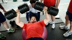 France's rugby union national team captain Pascal Pape lifts weights