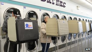 People cast their ballot at a polling station in a laundromat, November 6, 2012 in Chicago, Illinois in the US presidential election
