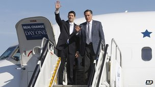 Governor Mitt Romney and his running mate Paul Ryan wave as they exit a campaign charter airplane Cleveland, Ohio 6 November 2012