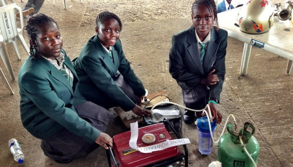 School girls show off their urine-powered generator, copyright Erik Hersman