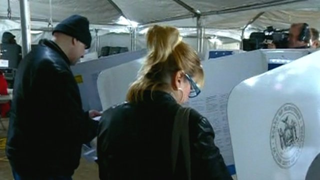 Voters in polling station tent