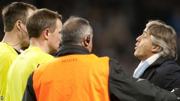 Manchester City boss Roberto Mancini remonstrates with officials at the final whistle