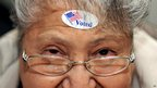 Dora A Winter of Nampa, looks up after an I Voted sticker was placed on her forehead