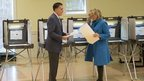 Mitt Romney and his wife Ann cast their votes at a polling station in Belmont, Massachusetts