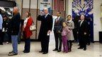 Vice-President Joe Biden waits in line to vote in Greenville, Delaware