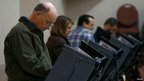 Voters cast their ballots on electric touch screen voting machines in Pineville, North Carolina