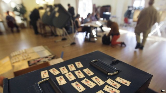 """""""I Voted"""" stickers are displayed atop a ballot box, ready to give to each voter at a polling station used by many college students on the campus of the University of Colorado, in Boulder, Colo"""