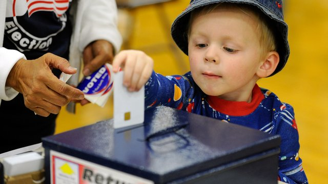 child helping parent vote in Nevada