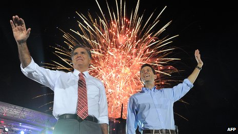 Mitt Romney and Paul Ryan campaigning together with fireworks going off behind them
