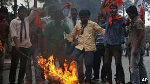 File photo: students demanding the creation of a new Telangana state burn an effigy during a protest in Andhra Pradesh on 1 November 2012