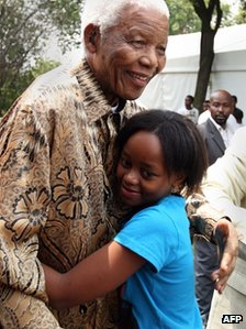 Nelson and Zenani Mandela hug in Soweto, South Africa, file photo from December 2008