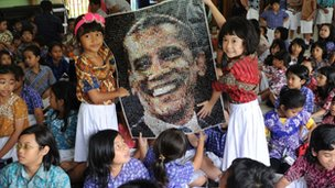 Students in Jakarta hold up a painting of Obama