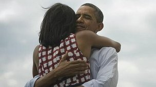 Barack Obama hugging Michelle Obama