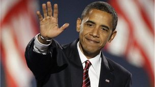 Obama salutes supporters after being re-elected president 