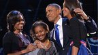 Barack Obama accompanied by (from left to right) by his wife Michelle and daughters Sasha and Malia in Chicago
