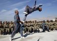 Members of the Afghan Local Police showcase their skills during a graduation ceremony in Laghman province November 7, 2012.