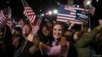 Supporters of US President Barack Obama cheer after networks project Obama as re-elected