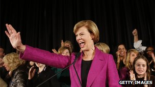 Tammy Baldwin waves to supporters