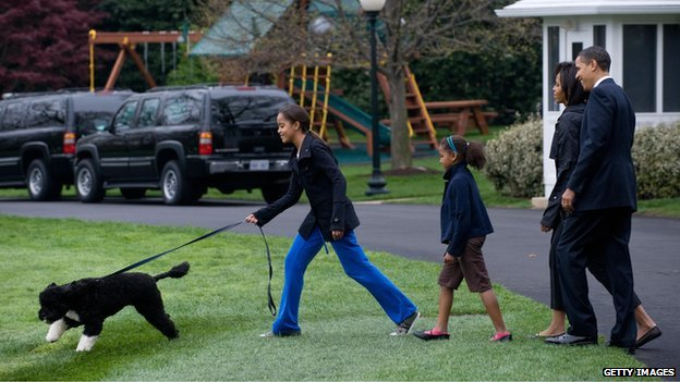 Obama family with dog