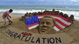 Obama's face constructed from a sand castle