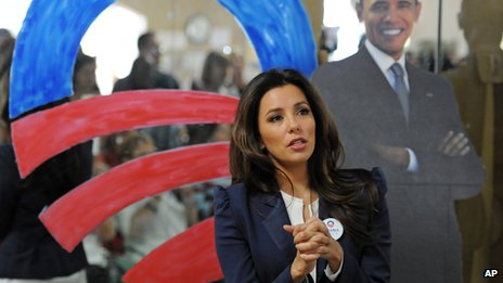 Actress Eva Longoria in front of a cut-out of President Obama