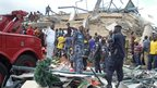 Rescue workers at the site of the shopping complex collapse in Ghana's capital, Accra - Wednesday 7 November 2012