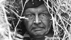 A camouflaged Clive Dunn in a scene from 1968 Dad's Army episode Operation Kilt