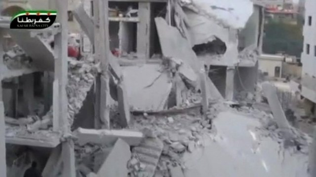 Still from unverified footage of damage to buildings in Damascas