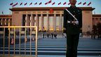 A policeman guards an entrance from Tiananmen Square to the Great Hall of the People, Beijing, 8 November 2012