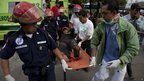 Firefighters transport a wounded resident in Guatemala