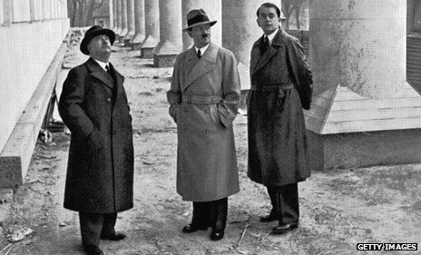 Hitler (centre) in hat and coat