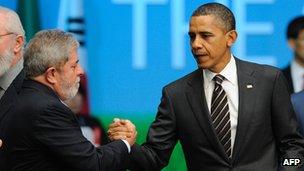 Luiz Inacio Lula da Silva, then Brazil's president, shakes hands with President Obama