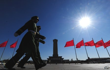 Paramilitary police march past the Monument to the People's Heroes on Tiananmen Square, Beijing