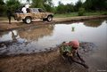 Soldiers smear mud on pick up trucks 