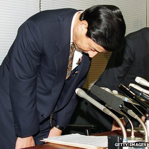 Shigeoki Togo, president of Nippon Credit Bank Ltd, bowing deeply after the Japanese government bailed out the debt-ridden bank in 1998