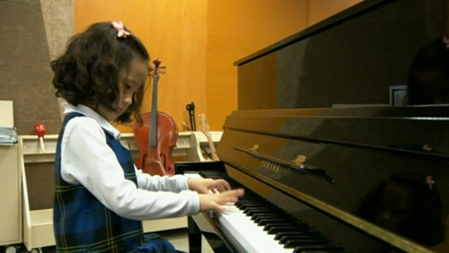 Child plays piano