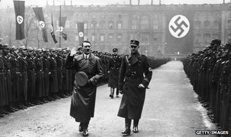 Hitler walking through a guard of honour