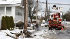 A utility worker checks a power line in Point Pleasant, New Jersey 8 November 2012