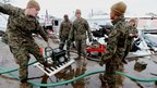US Marines start a generator in Breezy Point, New York 8 November 2012