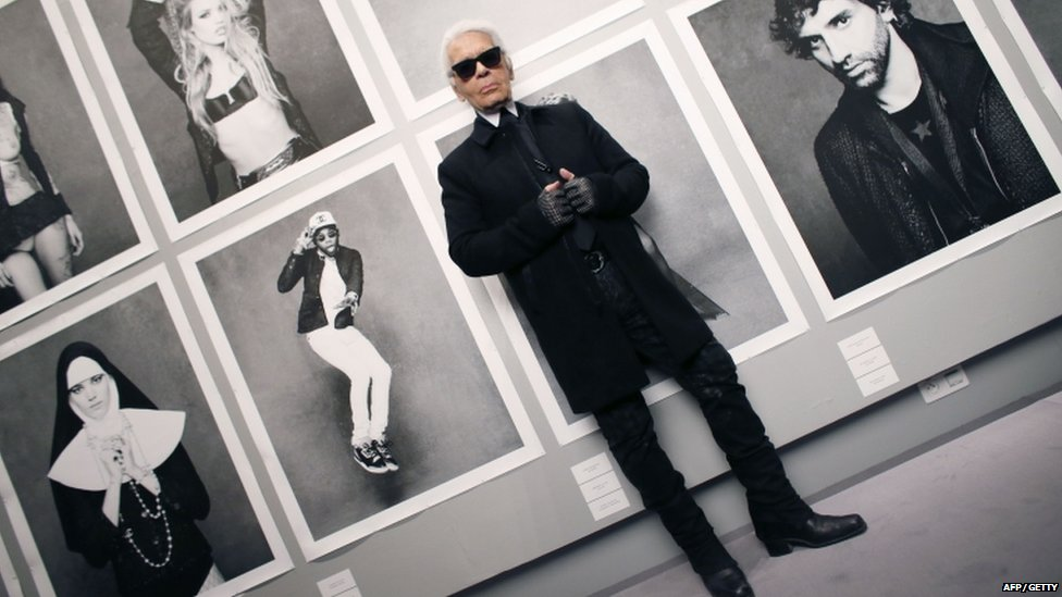 Chanel's creative director Karl Lagerfeld posing at the opening of his photo exhibition Little Black Jacket in Paris