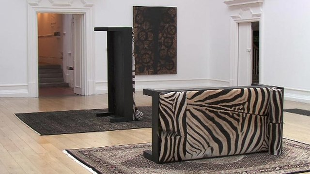 Two couch beds at unusual angles on rugs - part of Rashid Johnson's exhibition
